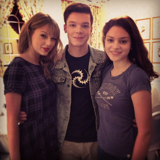 Taylor Swift poses with Cameron Monaghan and Odeya Rush on the set of The Giver